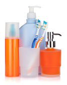 Cosmetics bottles, toothbrushes and liquid soap — Stock Photo