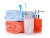 Toothbrushes, liquid soap and towels — Stock Photo
