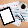 Tablet with blank screen over papers with numbers and charts — Stock Photo #22495323