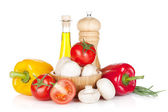 Fresh vegetables and mushrooms with olive oil and pepper shaker — Stock Photo