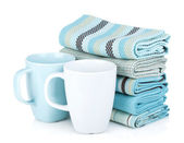 Kitchen towels and tea cups — Stock Photo