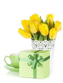 Yellow tulips, tea cup and gift box — Stock Photo