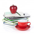Red coffee cup, ripe apple and office supplies — Stock Photo #24686133