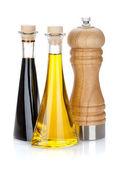 Olive oil and vinegar bottles with pepper shaker — Stock Photo