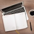 Notepad, laptop and coffee cup on wood table — Stock Photo #25944215