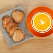 Cup with orange and cookies — Stock Photo
