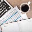 Stock Photo: Notepad, laptop and coffee cup on wood table