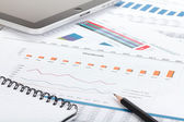 Financial papers, computer and office supplies — Stock Photo
