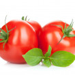 Three ripe tomatoes and basil — Stock Photo #26760457