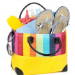 Stock Photo: Bag with towels, sunglasses, flip-flops and beach items
