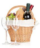 Picnic basket with bread, cheese, grape and wine bottles — Stock Photo