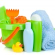 Beach baby toys, towels and bottles — Stock Photo #27194189