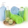 Bathroom bottles, towels and candles — Stock Photo