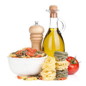Various pasta, tomato and condiments — Stock Photo