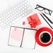 Red coffee cup, gift box and office supplies — Stock Photo