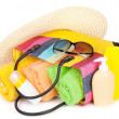 Bag with towels, sunglasses, hat and beach items — Stock Photo
