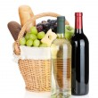 Picnic basket with bread, cheese, grape and wine bottles — Stock Photo #29350169