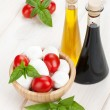 Stock Photo: Mozzarellcheese with cherry tomatoes and basil