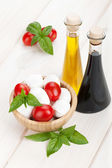 Mozzarella cheese with cherry tomatoes and basil — Stock Photo