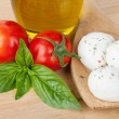 Mozzarella, olive oil, tomatoes and basil — Stock Photo