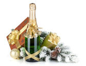 Champagne bottle, christmas gift box, decor and fir tree — ストック写真