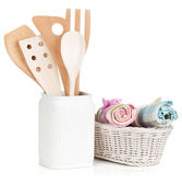 Kitchen utensils in holder and towels — Stock Photo