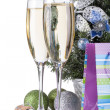 Champagne glasses, firtree and christmas decor — Stock Photo