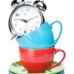 Coffee cups and alarm clock — Stock Photo