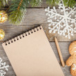 Christmas fir tree, decor and blank notepad on wooden board back — Stockfoto