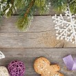 Christmas fir tree and decor on wooden board background — ストック写真
