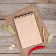 Blank notepad on wooden table — Stock Photo