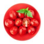 Cherry tomatoes and basil — Stock Photo