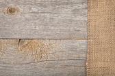 Burlap texture on wooden table — Stock Photo