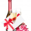 Champagne bottle and red rose flowers — Stock Photo #33103297