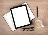 Tablet with blank screen and coffee cup — Stock Photo
