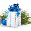 Christmas gift box and baubles — Stock Photo