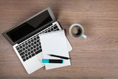 Notepad over laptop and coffee cup — Stok fotoğraf