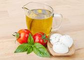 Mozzarella, olive oil, tomatoes — Stock Photo