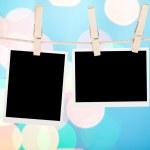 Blank photos hanging on clothesline — Stock Photo