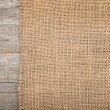 Foto Stock: Burlap texture on wooden table