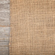 Burlap texture on wooden table — Stok fotoğraf