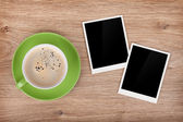 Cup of coffee and two photo frames — Stock Photo