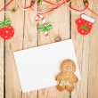 Christmas decor, gingerbread cookie and card for copy space — Stock Photo