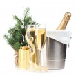 Champagne bottle in ice bucket, two glasses and christmas gift — Stock Photo #35665215