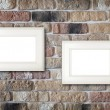 Photo frames on brick wall — Stock Photo