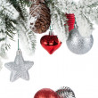 Fir tree branch with christmas decor covered with snow — Stock Photo