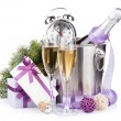 Christmas champagne with alarm clock in bucket and gift box — Stock Photo