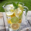 Pitcher with homemade lemonade — Stock Photo