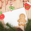 Christmas fir tree, gingerbread cookies and card for copy space — Stock Photo