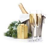 Champagne bottle in ice bucket, two glasses and christmas gift — Stockfoto